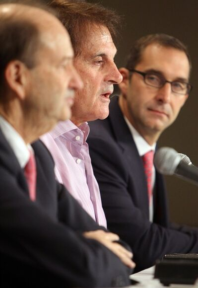St. Louis Cardinals manager Tony La Russa, center, speaks at a news conference at Busch Stadium in St. Louis, Monday, Oct. 31, 2011, flanked by team owner Bill DeWitt Jr., left, and general manager John Mozeliak. La Russa retired as manager of the Cardinals, three days after winning a dramatic, seven-game World Series against the Texas Rangers. (AP Photo/St. Louis Post-Dispatch, Chris Gooden) EDWARDSVILLE INTELLIGENCER OUT. THE ALTON TELEGRAPH OUT
