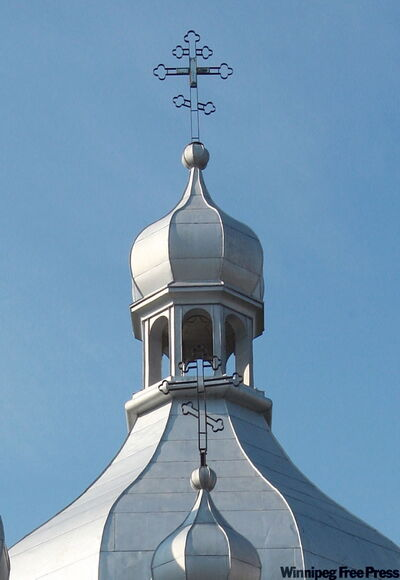The Orthodox cross you see on top of domes has three cross-pieces, with the bottom crosspiece running at a diagonal.