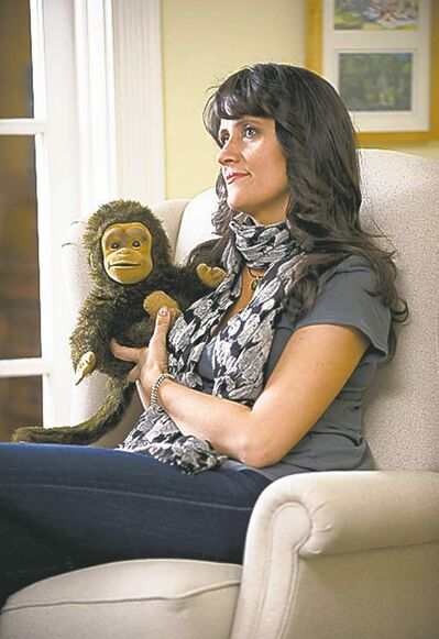 Nina Conti touches her monkey.