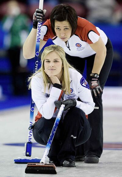 Skip Jennifer Jones, bottom and second Jill Officer, top, during the 2010 Scotties Tournament of Hearts. The two curlers have one of the sports most enduring partnerships.