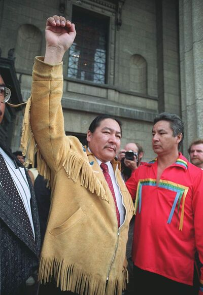 June 22, 1990: NDP MLA Elijah Harper salutes supporters from the steps of the Manitoba Legislature after refusing to let the debate on the Meech Lake Accord go any further.