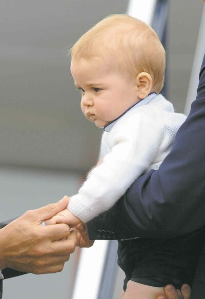 "FILE - This is a Wednesday, April 16, 2014  file photo of Britain's Prince George's as his hand is held by New Zealand Governor General  Jerry Mateparae as he leaves with his parents Prince William and Kate, the Duchess of Cambridge on a plane bound for Sydney, Australia from Wellington, New Zealand. Prince George turns 1 on Tuesday. While he may be too young to appreciate it, the milestone is causing a nationwide frenzy. Editorial writers call him a symbol of hope, newspaper headlines hail him as ""Gorgeous George"" and one published a 24-page glossy magazine chronicling his first 12 months. (AP Photo/SNPA, Ross Setford, File) NEW ZEALAND OUT"