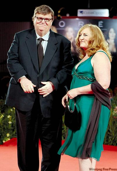 Michael Moore with wife Kathleen Glynn in 2009.