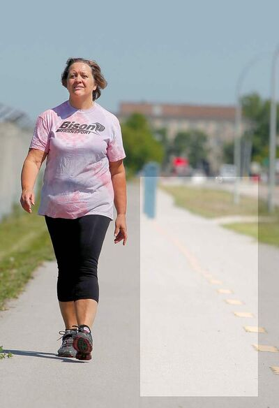 Cheryl Funk lost 50 pounds by training for the upcoming Challenge for Life walk for cancer. BORIS MINKEVICH / WINNIPEG FREE PRESS