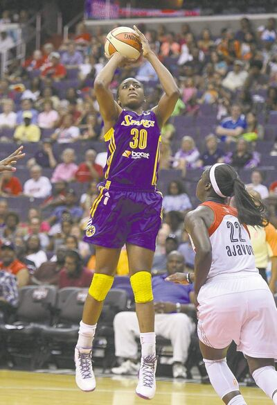 Los Angeles Sparks forward Nneka Ogwumike (30) hits a jump shot over Washington Mystics guard Matee Ajavon (22) in the second quarter at the Verizon Center in Washington, D.C., Sunday, August 4, 2013, (Chuck Myers/MCT)