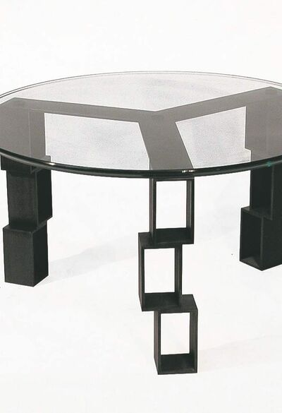 "Rafael Avramovich's ""Positive Space/Coffee Table,"" made of blacken steel finish with a circular glass top."