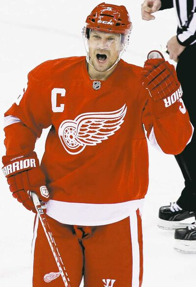 FULL CLOSE CUT CLOSECUT - Detroit Red Wings defenseman Nicklas Lidstrom, of Sweden, celebrates his assist on the goal by defenseman Niklas Kronwall during the third period of an NHL hockey game against the St. Louis Blues in Detroit, Monday, Jan. 23, 2012. Detroit won 3-1. (AP Photo/Carlos Osorio)