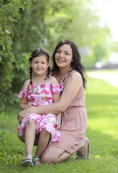 RUTH BONNEVILLE / WINNIPEG FREE PRESS</p><p>Jocelyn McKay, 27, with her daughter, Zoe, was impressed with how many opportunities the program opened up for her.</p>