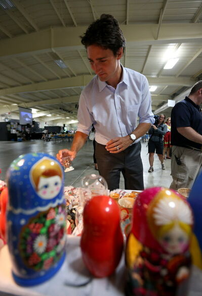 Trudeau checks out the nesting dolls at the Ukrainian pavilion.