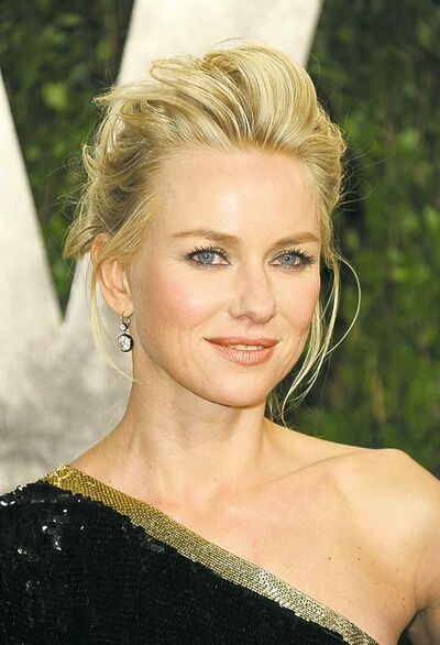 Actress Naomi Watts arrives at the 2013 Vanity Fair Oscar party on Sunday, Feb. 24, 2013 at the Sunset Plaza Hotel in West Hollywood, Calif. (Jordan Strauss / Invision / The Associated Press archives)