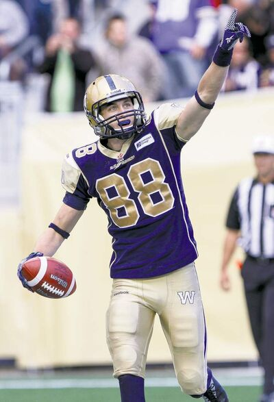 JESSICA BURTNICK / WINNIPEG FREE PRESS archivesJade Etienne celebrates the first touchdown of the game against Calgary.