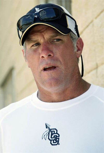 FILE - In this July 30, 2012, file photo, former NFL quarterback Brett Favre, now an assistant football coach at Oak Grove High School in Hattiesburg, Miss., speaks about the transition from player to coach during the first day of official practice for the fall high school football season. The retired three-time Super Bowl MVP quarterback will join the NFL Network's crew for daylong coverage on Sunday for Super Bowl XLVII between the Baltimore Ravens and San Francisco 49ers. AP Photo/Rogelio V. Solis, File)
