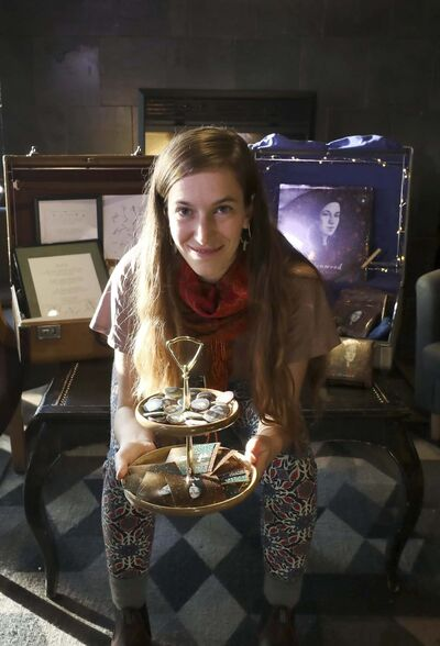 Local musician and artist Madeleine Roger sells her own bags, sketch art, pins, buttons along with her records and CD's at her concerts. (Ruth Bonneville / Winnipeg Free Press)