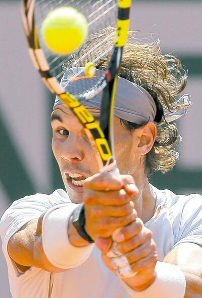 Spain's Rafael Nadal (above) and Serbia's Novak Djokovic fought a brutal tennis war at Roland Garros on Friday.
