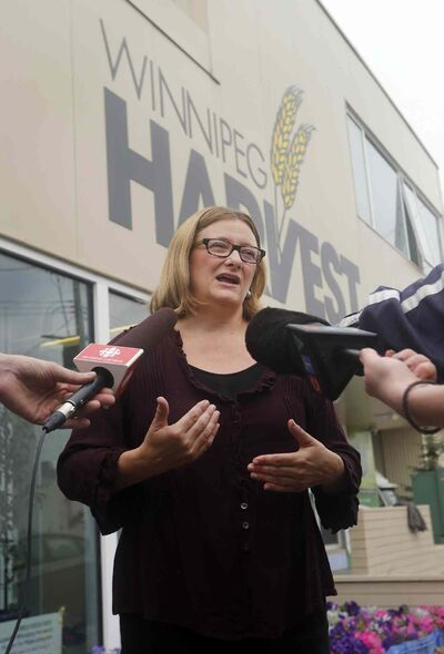 Paula Havixbeck at Winnipeg Harvest, making a campaign announcement about bringing Mealshare to Winnipeg.
