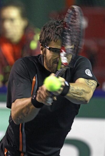 Janko Tipsarevic of Serbia returns the ball to Tomas Berdych of Czech Republic during their match in the Paris Tennis Masters tournament, Thursday, Nov.10, 2011, in Paris, France. (AP Photo/Lionel Cironneau)