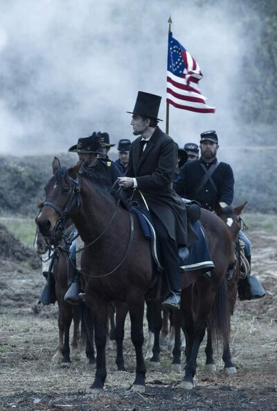 Daniel Day-Lewis, centre, as President Abraham Lincoln, looks across a battlefield in the aftermath of a terrible siege in this scene from director Steven Spielberg's drama Lincoln.