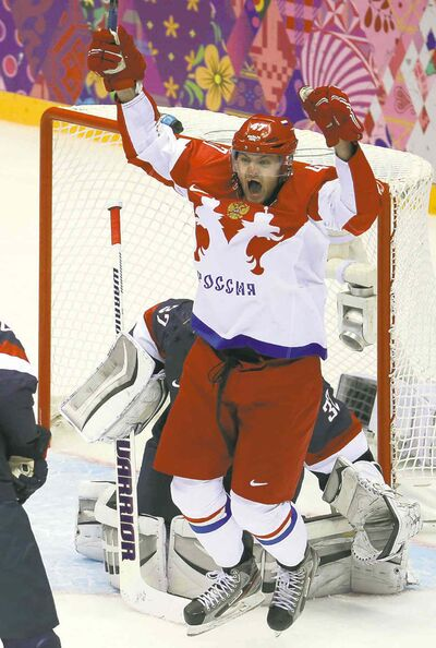 Russia forward Alexander Radulov (47) celebrates a goal by teammate Pavel Datsyuk against USA goalie Jonathan Quick (32) in the third period of a men's hockey game at Bolshoy Ice Dome during the Winter Olympics in Sochi, Russia, Saturday, Feb. 15, 2014. USA defeated Russia, 3-2. (Brian Cassella/Chicago Tribune/MCT)