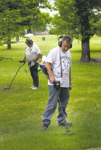Treasure hunters Eric Hanlan and Randall Fedeluk listen for the sounds of lost metal.