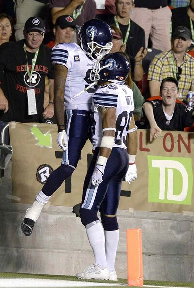 Darvin Adams (9) celebrates with Spencer Watt (89) after scoring a touchdown for the Argos against the Ottawa Redblacks in July.