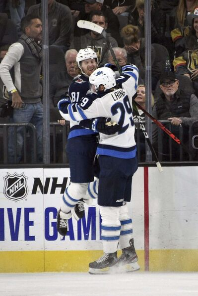 Kyle Connor celebrates with Patrik Laine after scoring in OT Saturday (right).</p>