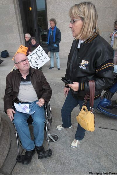 MS sufferers Rick Keith and Hanna Finnbogason demanded action during rally at the legislature.