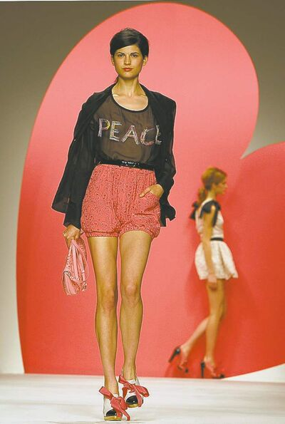 A model wears a creation from Moschino Cheap and Chic.