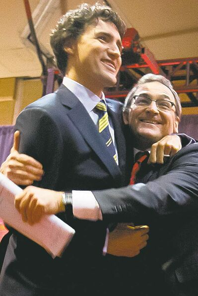Darryl Dyck / The Canadian PressFederal Liberal leadership candidates  Justin Trudeau (left) and Martin Cauchon embrace after the party�s first leadership debate  in Vancouver on Sunday.