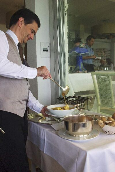 Serving bouillabaisse at Bacon in Antibes.