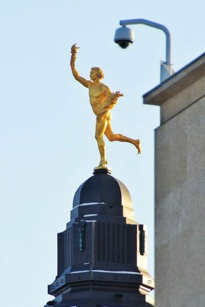 A security camera on the Great West Life building seems to keep watch over the Golden Boy on the Manitoba Legislative building as the sun rises early on New Year's Day.