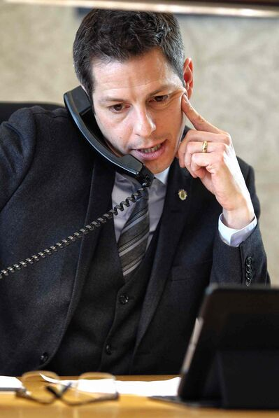 Mayor Brian Bowman speaks to a caller during a virtual town hall Monday morning.