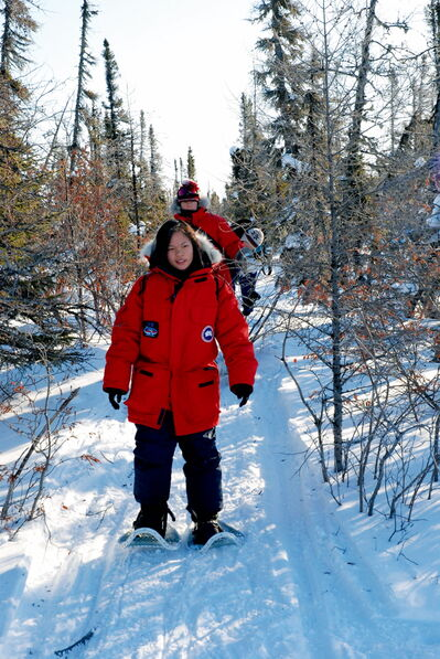 Daniel McIntyre Collegiate Institute student Angela Concepcion snowshoes near Churchill while participating in the Schools on Tundra program.