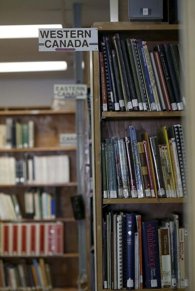 History and reference books fill the shelves.</p></p>