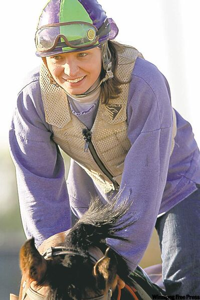 Janine Stianson takes Smoke'em All for a ride  at  Assiniboia Downs.