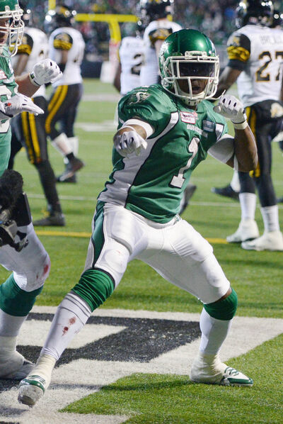 Roughriders running back Kory Sheets celebrates a TD during the fourth quarter Sunday. The MVP ran for 197 yards in the win.