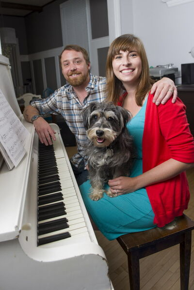 Savanna and Rusty Matyas with their Miniature Schnauzer Otto.