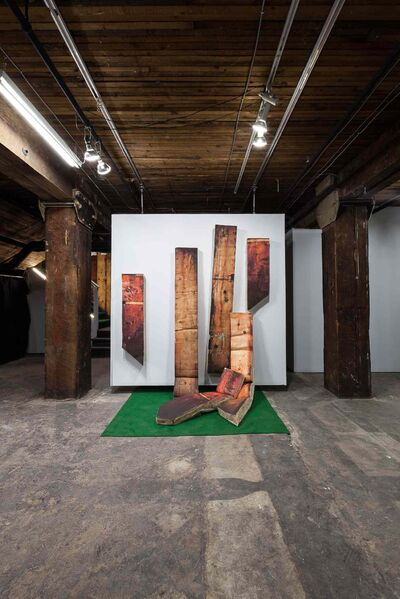 Make - Soft makes its own statement by pointing out the seemingly ordinary features of the Raw gallery. Above: wooden pillars.