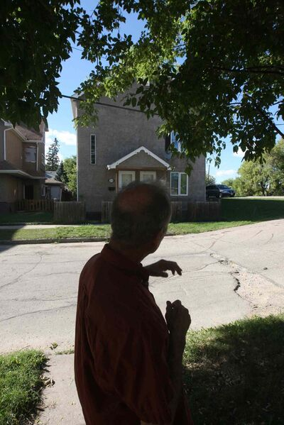Burrows points out a Point Douglas success story on his street, where a former drug den has been turned into a duplex. (Joe Bryksa / Winnipeg Free Press)