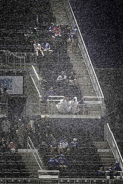 PHIL HOSSACK / WINNIPEG FREE PRESS - Dedicated Blue Bomber fans cling to their seats in pouring rain after a game delay due to lightning put a stop to play against Edmonton's Eskimos Thursday evening.  - June 14, 2018