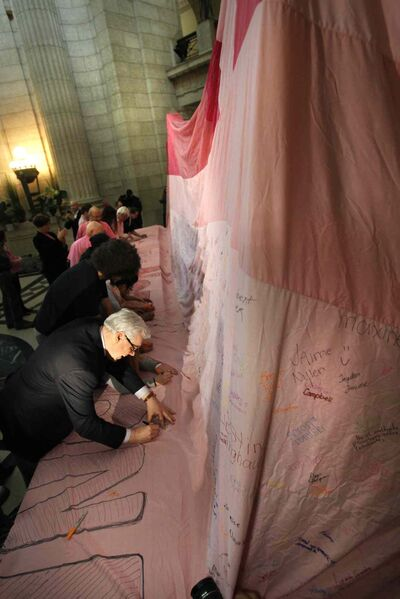 Premier Greg Selinger adds his signature to join the more than 7000 people who have already signed the huge anti-bullying blanket on display in the Manitoba Legislative building today.