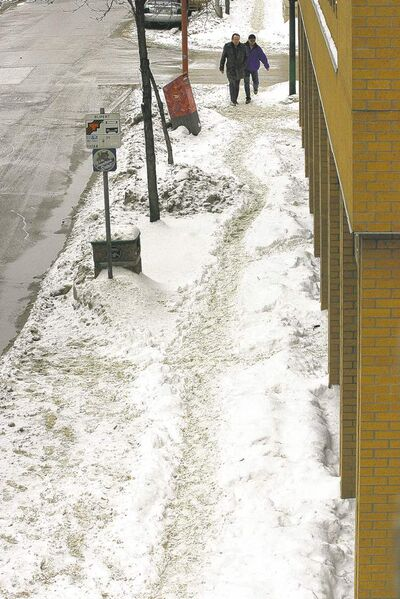 Pedestrians navigate a narrow, snow-rutted pathway along King Street near Rupert Avenue and on Princess Street (below).