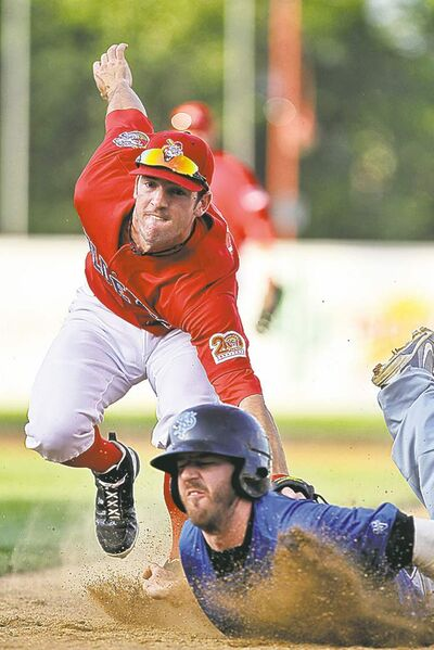 mike deal / winnipeg free pressGoldeyes shortstop Nick Liles (8) tags Saints� Adam Frost (2) at first in the second inning.