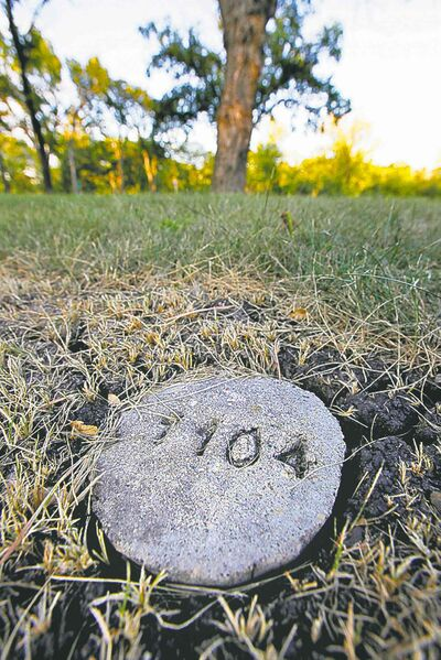 A stone marker is all that marks Phoenix Sinclair's grave at Brookside Cemetery.