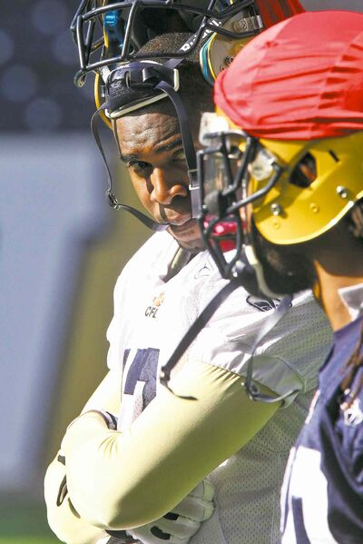 Winnipeg Blue Bombers receiver Mike Sims-Walker takes a breather during practice at Investors Group Field Wednesday.