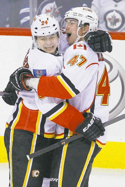 Calgary Flames Jiri Hudler (24) and Sven Baertschi (47) celebrate Hudler's goal in the third period.