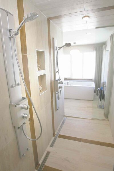 Double shower in the bathroom off of the master bedroom.