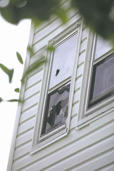PHOTOS BY ruth bonneville / winnipeg free pressThe house at 512 Stella Ave.,  the home in which Andrew Baryluk (inset) lived before he died following a 17-hour standoff with Winnipeg police. Bullet holes are visible in an upstairs window.