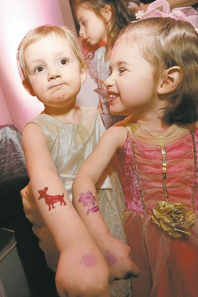 Luzy Enns, 3, and her cousin, Sonja Kuhl, 2, show off their glitter tattoos at the first annual Royal Princess Ball in support of The Children's Hospital Foundation of Manitoba.