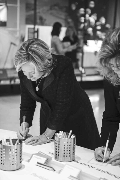 Hillary Clinton fills out an Imagine card during her visit to the Canadian Museum for Human Rights.