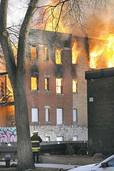 John Woods / Winnipeg Free Press Fire crews work to extinguish a blaze in a vacant building on Hargrave Street Monday.
